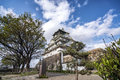 Osaka castle in Japan with light blue sky Royalty Free Stock Photo