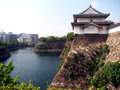 Osaka castle rampart in japan water moat separating the modern city and the old Royalty Free Stock Photography
