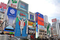 Osaka japan oct the glico man running billboard and other neon displays on october in dotonbori dotonbori has many Stock Photos