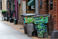 Oscar s home of boogie blues trash cans in an alley in nashville tn with and and the grouch spray painted on them Stock Image
