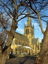 Ossett church thro trees in winter with a light covering of snow looking through the Royalty Free Stock Photo
