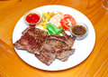 Ostrich steak with salad on table Stock Image