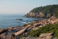 Otter Cliffs and slabs of Pink Granite Rocks left over from the