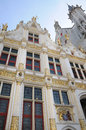 Oude griffie this building is the the old chambers with the city coat of arms at burg square in bruges belgium Stock Photo