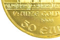Ounce gold coinage on a golden coin ounces Stock Photo