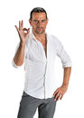 Oung handsome man showing ok sign young on a white background Royalty Free Stock Photo