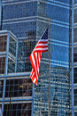 Our flag the u s flying in a corporate america setting Royalty Free Stock Images