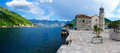 Our lady of the rocks church perast montenegro june panoramic view and town perast with local and tourists bay Royalty Free Stock Images