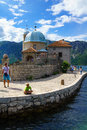 Our lady of the rocks church perast montenegro june scene with local and tourists on an artificial island in bay kotor Royalty Free Stock Images