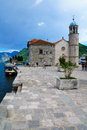 Our lady of the rocks church perast montenegro june scene with local and tourists on an artificial island in bay kotor Stock Images