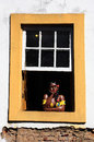 Ouro preto painted women window minas gerais brazil at a of the unesco world heritage city of in Royalty Free Stock Image