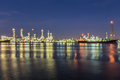 Out of focus, Oil refinery at twilight with river reflection Royalty Free Stock Photo