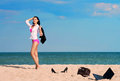 Out of office – vacation at sea businesswoman walks towards to leaving her laptop shoes and bag on the sand Stock Image
