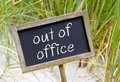 Out of Office Sign on Beach Royalty Free Stock Photo