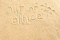 Out of office sign on beach sand Royalty Free Stock Photo