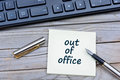 Out of office words on notes Royalty Free Stock Photo