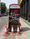 An out of order telephone box london uk july bt with cones and tape around it to prevent people from trying to use it the Royalty Free Stock Image