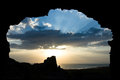 Out to the light a sunset framed in a cave entrance Royalty Free Stock Photo