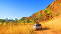 Outback australia - driving a 4x4 four wheel drive to camping spot near Lake Argyle Royalty Free Stock Photo