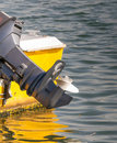 Outboard engine with a lake background Stock Photo