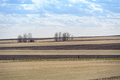 Outdated barn and fields in canadian prairies woodrow saskatchewan Royalty Free Stock Images