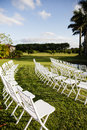 Outdoor audience seating rows of white folding chairs on a green lawn used for or spectator Royalty Free Stock Photos