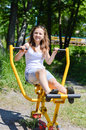 Outdoor boot camp fitness sessions: portrait of beautiful girl young woman having fun happy smiling doing exercise Royalty Free Stock Photo