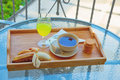 Outdoor breakfast an table with tea biscuits ornage juice banana Stock Photo