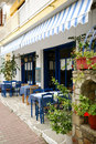 Outdoor cafe in greek town Stock Images