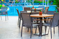 Outdoor cafes near the swimming pool at dawn Royalty Free Stock Photos