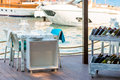 Outdoor cafes on the pier near yachts Royalty Free Stock Photography