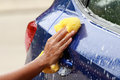 Outdoor car wash with yellow spong Royalty Free Stock Photos