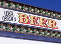 Outdoor carnival festival ice cold beer concessions concession sign at celebration Royalty Free Stock Photo