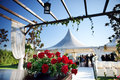 Outdoor ceremony beautiful venue with flowers and blue sky Royalty Free Stock Photos