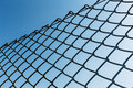 Outdoor chain link fence with blue sky Stock Images