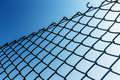 Outdoor chain link fence under blue sky Royalty Free Stock Photography