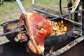 Outdoor cooking - pork shank Stock Photos
