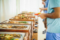 Outdoor Cuisine Culinary Buffet Dinner Catering. Group of people in all you can eat. Dining Food Celebration Party Concept. Servic Royalty Free Stock Photo