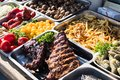 Outdoor Cuisine Culinary Buffet with healthy take away meal - grilled vegetables, fish and meat on the street food culinary market Royalty Free Stock Photo