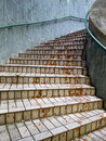 Outdoor curve stairs after rain with green wall wet with leaf litter Royalty Free Stock Image