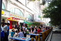 Outdoor dining and tourists in china shenzhen baoan jiaan road vanguard supermarket outside the leisure table Royalty Free Stock Photo