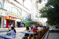 Outdoor dining and tourists in china shenzhen baoan jiaan road vanguard supermarket outside the leisure table Stock Photos