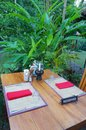 Reserved table, Outdoor dining, tropical resort Royalty Free Stock Photo