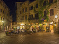 Outdoor dining in tuscany diners eating at an restaurant the italian village of san gimignano Stock Photography
