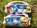 Outdoor easter egg hunt small eggs collected by children from an in the fields Royalty Free Stock Image