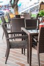 Empty cafe with rattan armchairs Royalty Free Stock Photo