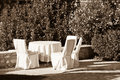Outdoor empty summer cafe table with chairs sepia Royalty Free Stock Images