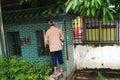 In outdoor eniao uncivilized behavior shenzhen baoan xixiang sidewalk an old man the Royalty Free Stock Photos