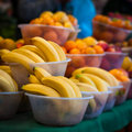 Outdoor farmer's market selling fruit in bowls Royalty Free Stock Photo
