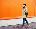 Outdoor fashion photo of stylish hipster cool girl walking Royalty Free Stock Photo